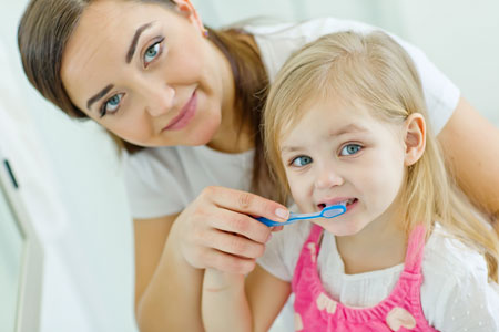 Mom and Daughter brushing their teeth - Pediatric Dentist in Jackson, New Jersey